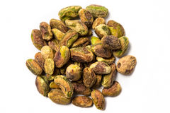 Unshelled pistachios. On a white background Stock Image