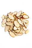 Unshelled sliced almonds. On a white background Royalty Free Stock Image