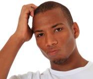 Unsicherer schwarzer Mann Stockfoto