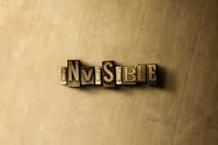 UNSICHTBAR - Nahaufnahme der grungy Weinlese setzte Wort auf Metallhintergrund Lizenzfreie Stockbilder