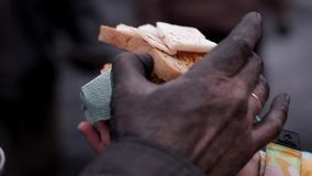 Unskilled worker dines. Miner eats bread with lard. Unskilled worker dines stock video