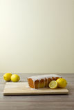 Unsliced glazed lemon loaf cake Royalty Free Stock Photography