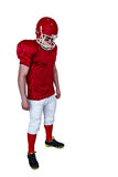 Unsmiling american football player looking down Stock Photography
