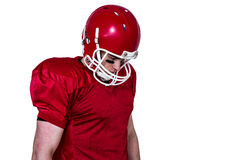Unsmiling american football player looking down Stock Photos
