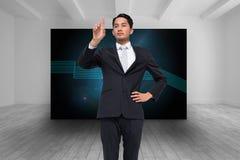 Unsmiling asian businessman pointing Stock Photos