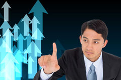 Unsmiling asian businessman pointing Royalty Free Stock Photography