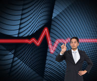 Unsmiling asian businessman pointing Stock Photography