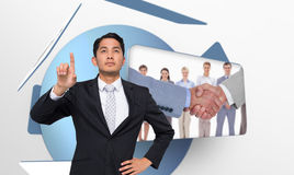 Unsmiling asian businessman pointing Royalty Free Stock Image