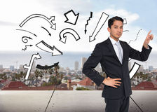 Unsmiling asian businessman pointing Stock Images