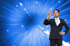 Unsmiling asian businessman pointing Royalty Free Stock Photos