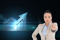 Unsmiling asian businesswoman pointing Stock Image