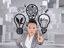 Unsmiling asian businesswoman pointing Stock Photography