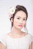 Unsmiling Asian woman Stock Photography