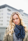 Unsmiling attractive blonde posing outdoors Royalty Free Stock Photo
