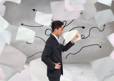 Unsmiling azjatykci biznesmena wskazywać Zdjęcie Stock