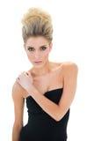 Unsmiling beautiful blonde model looking at camera Stock Image
