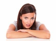 Unsmiling beautiful female looking at camera Stock Images