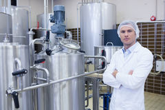 Unsmiling biologist with arms crossed Royalty Free Stock Photo