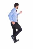 Unsmiling biznesmen w kostiumu kroczeniu Fotografia Stock