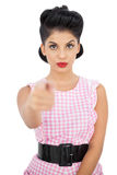 Unsmiling black hair model pointing a finger at camera Stock Photo