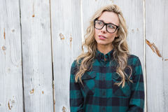 Unsmiling blonde standing and thinking Royalty Free Stock Image