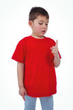 Unsmiling boy looking at his finger. On white screen Royalty Free Stock Photos