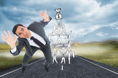 Unsmiling businessman with arms raised Royalty Free Stock Photo