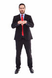 Unsmiling businessman with clenched fist in front of him Stock Photo