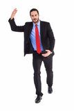 Unsmiling businessman holding something with hands Royalty Free Stock Photos