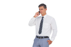 Unsmiling businessman on the phone Royalty Free Stock Images