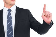 Unsmiling businessman pointing his finger Stock Image