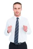 Unsmiling businessman presenting his fists Royalty Free Stock Photos