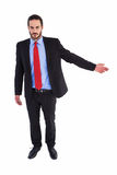Unsmiling businessman showing something with his hand Royalty Free Stock Photography
