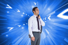 Unsmiling businessman standing Royalty Free Stock Photos