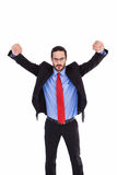 Unsmiling businessman standing with arms raised Royalty Free Stock Images