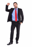 Unsmiling businessman standing with hand raised Royalty Free Stock Photography