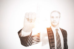 Unsmiling businessman in suit pointing up his finger Royalty Free Stock Images