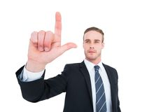 Unsmiling businessman in suit pointing up his finger Royalty Free Stock Photography