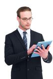 Unsmiling businessman using tablet pc Stock Photography