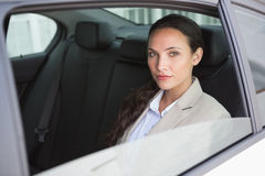 Unsmiling businesswoman looking at camera Royalty Free Stock Photos