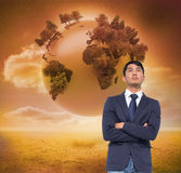 Unsmiling casual businessman with arms crossed Stock Images