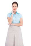 Unsmiling classy businesswoman posing Royalty Free Stock Photography