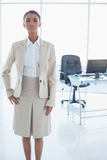 Unsmiling elegant businesswoman posing. In bright office Royalty Free Stock Photos