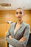 Unsmiling lawyer looking at camera crossed arms Royalty Free Stock Images