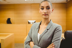 Unsmiling lawyer looking at camera crossed arms Royalty Free Stock Image