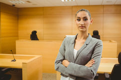 Unsmiling lawyer looking at camera crossed arms Stock Photos