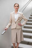 Unsmiling stylish businesswoman standing with hand on hip Royalty Free Stock Photography