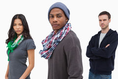 Unsmiling stylish young people in a row Stock Image