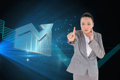 Unsmiling thinking asian businesswoman pointing Royalty Free Stock Image