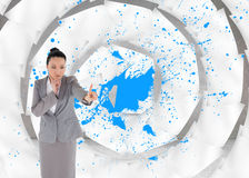 Unsmiling thinking asian businesswoman pointing Stock Images